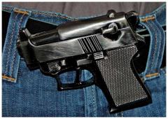 Gürtelschnalle Waffe